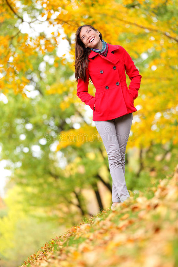 Autumn woman happy lifestyle in fall forest. Asian female model walking in autumn foliage enjoying beautiful fall colors. Full length portrait of ethnic Asian royalty free stock photos