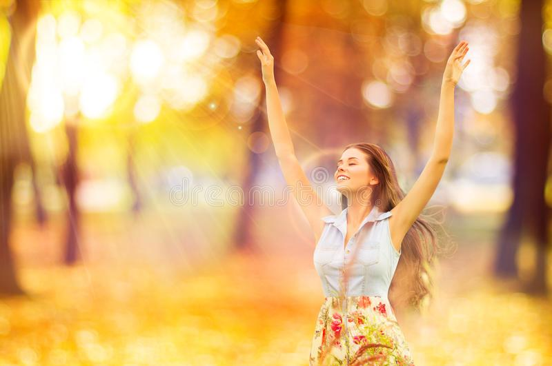 Autumn Woman, Happy Young Girl, Floating Model Open Arms in Yell. Ow Sunny Forest stock photo