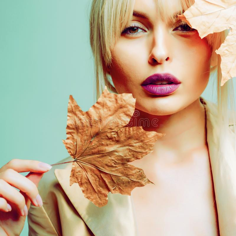 Autumn woman. Hello September. Model face close-up. Autumnal foliage. Autumn Clothing. Autumn leaves background. Autumn. Clothing and color trends stock images