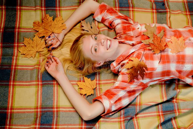 Autumn woman holding gold leaf. Beautiful sensual blonde playing with leaves. Fashion portrait of beautiful sensual royalty free stock photos