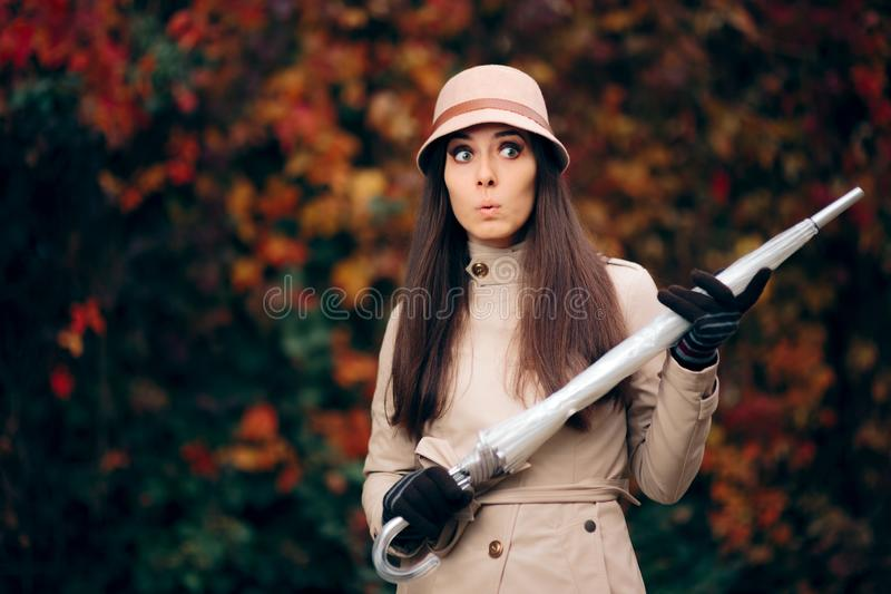 Autumn Woman Wearing a Rain Coat Holding an Umbrella royalty free stock photos