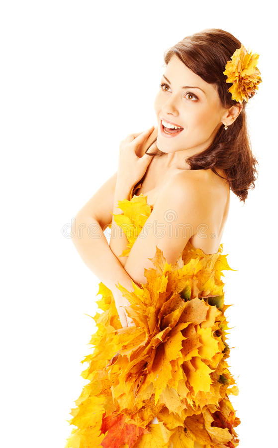Autumn woman in yellow dress of maple leaves. Autumn woman in fashion yellow dress of maple leaves holding bouquet of maple leaves over white background stock photography