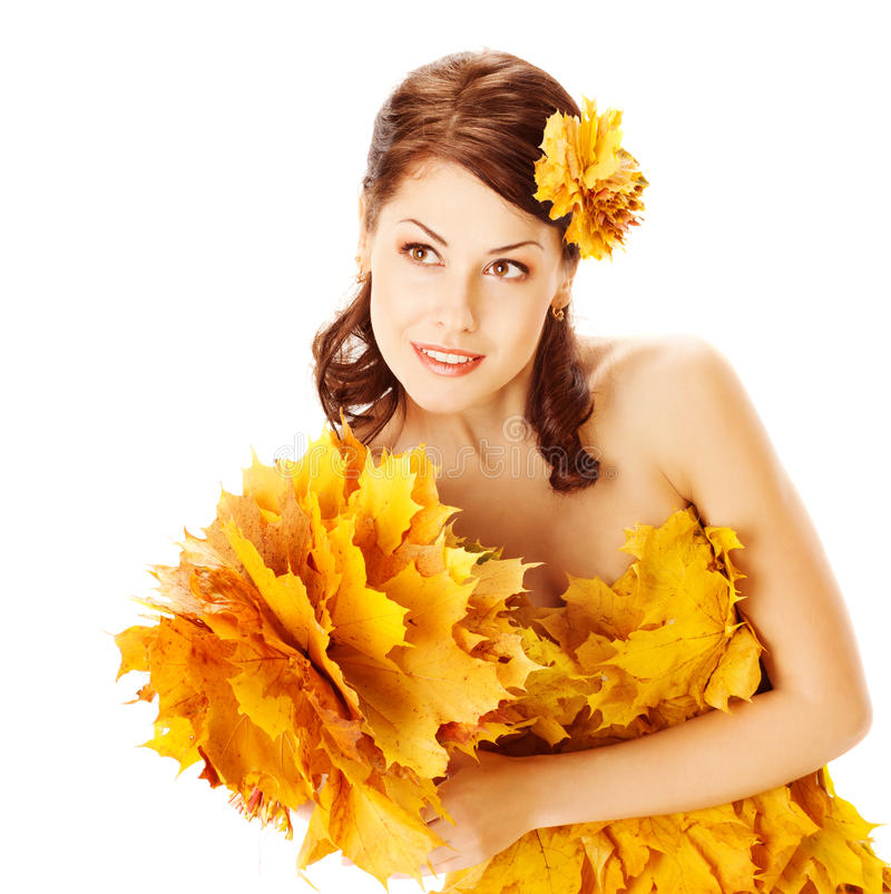 Autumn woman in yellow dress of maple leaves. Autumn woman in fashion yellow dress of maple leaves holding bouquet of maple leaves. White background stock images