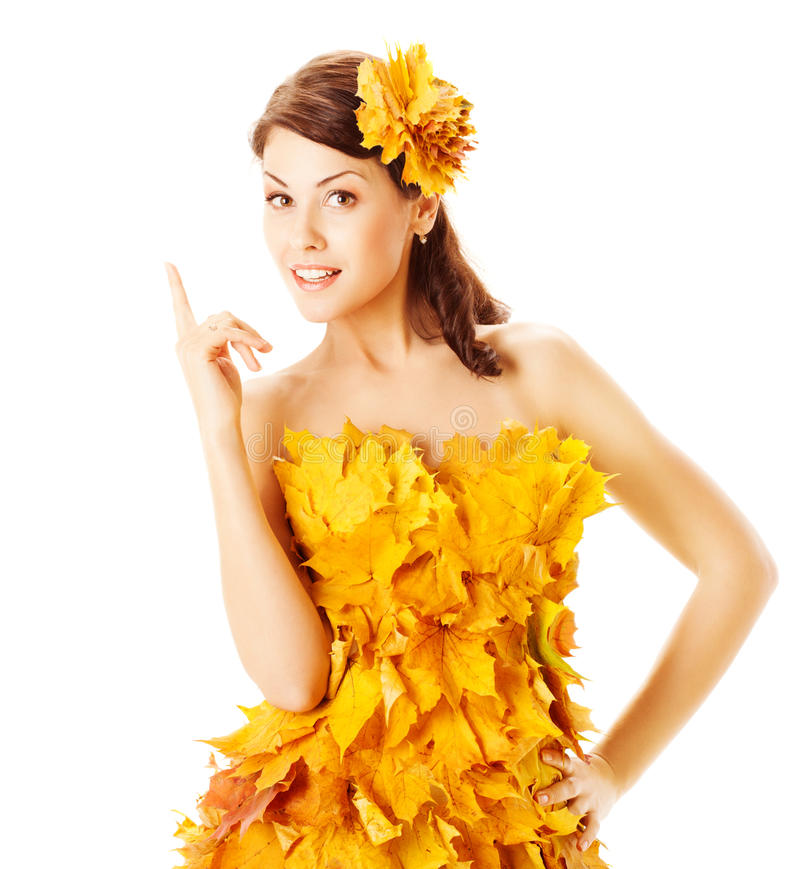 Autumn woman in yellow dress of maple leaves. Autumn woman in yellow fashion dress of maple leaves over white background stock photo