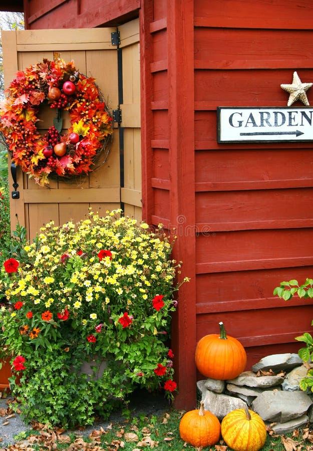 Autumn wreath. On barn door stock photography
