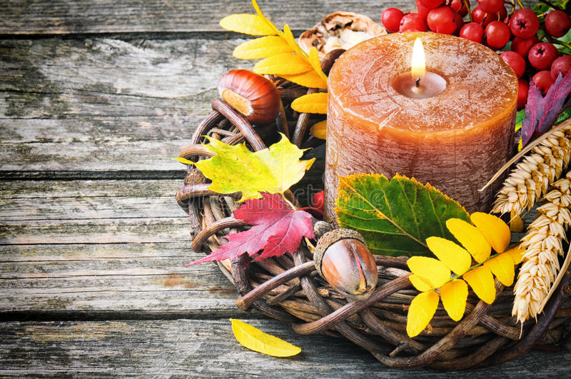 Autumn wreath with candle. On wooden background stock image