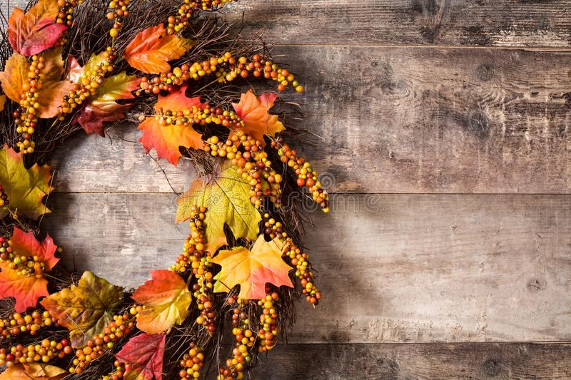 Autumn wreath on wooden background. Thanksgiving concept. royalty free stock image