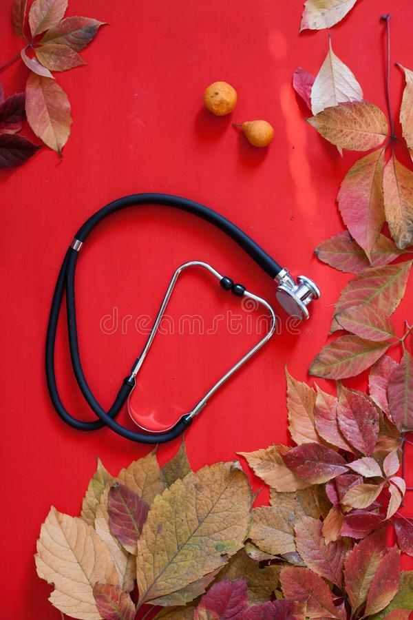 Autumn yellow leaves medical stethoscope c q royalty free stock images