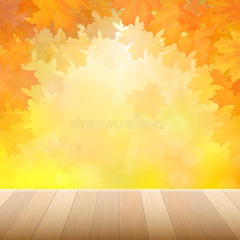 Autumn yellow leaves and wooden desk. royalty free stock image