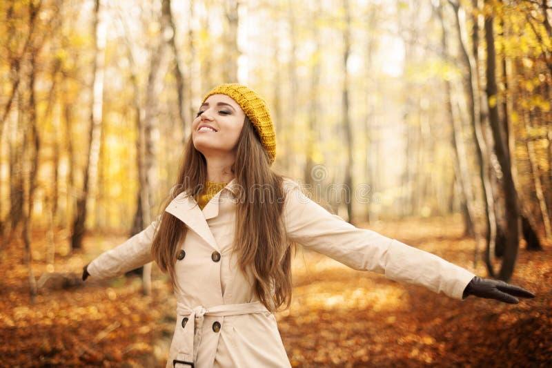 Autumn. Young woman enjoying nature at autumn stock photo
