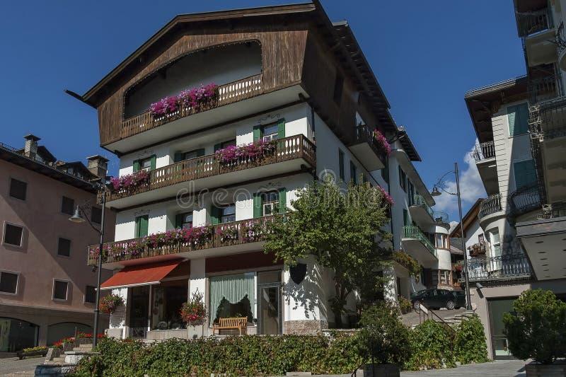 Autumnal corso Italia, the main street in the town centre, Cortina d`Ampezzo, Dolomites, Alps, Veneto. Italy, Europe stock photos
