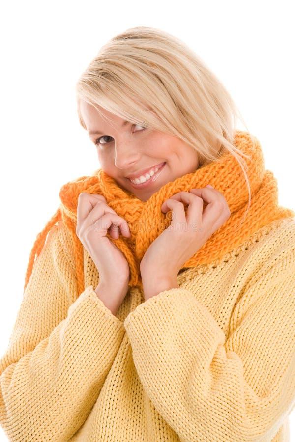 Autumnal girl wearing scarf royalty free stock image