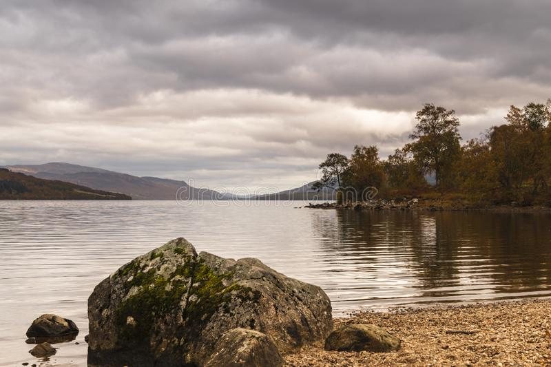 Loch Rannoch Rock. An autumnal image of Loch Rannoch from the south side, Perth and Kinross, Scotland. 18 October 2018 stock image
