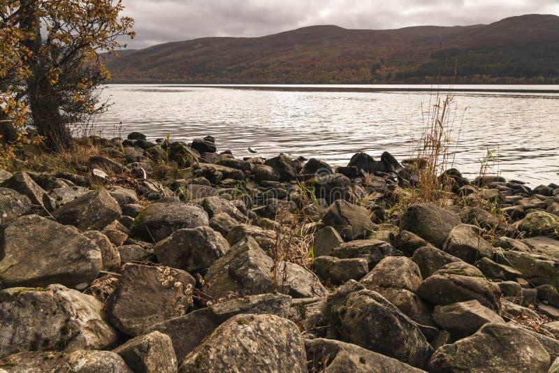 Loch rannoch. An autumnal image of rocks on the shoreline of Loch Rannoch in the Scottish Highlands. 18 October 2018 stock photo