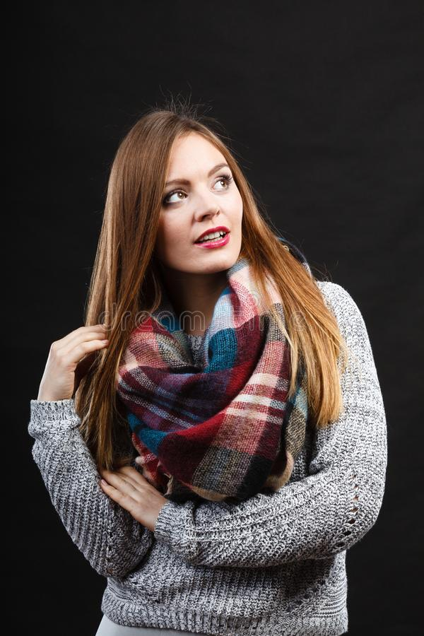Smiling girl wearing warm wooden scarf stock photography