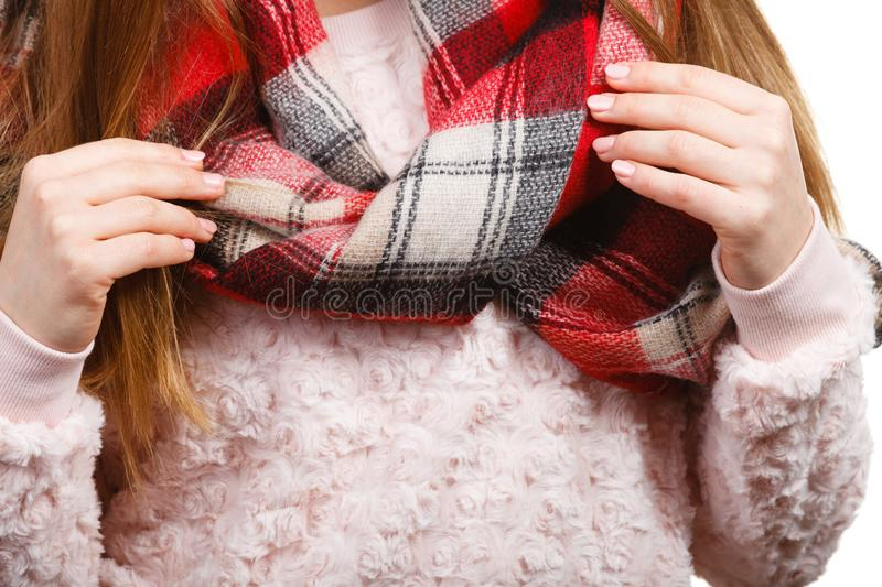 Woman shoulders wearing woolen checked scarf royalty free stock photography