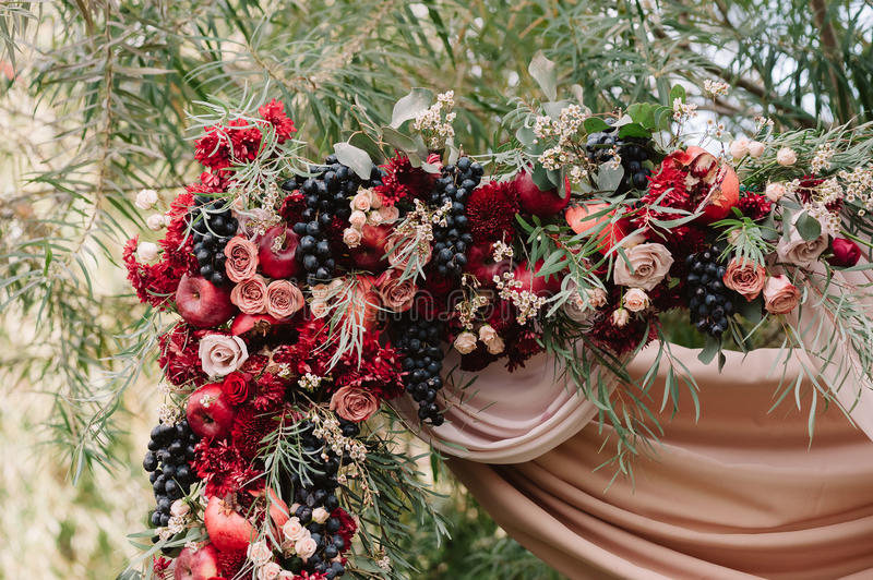 Autumnal wedding decoration of roses apples grape and pomergranate download autumnal wedding decoration of roses apples grape and pomergranate stock image image junglespirit Image collections