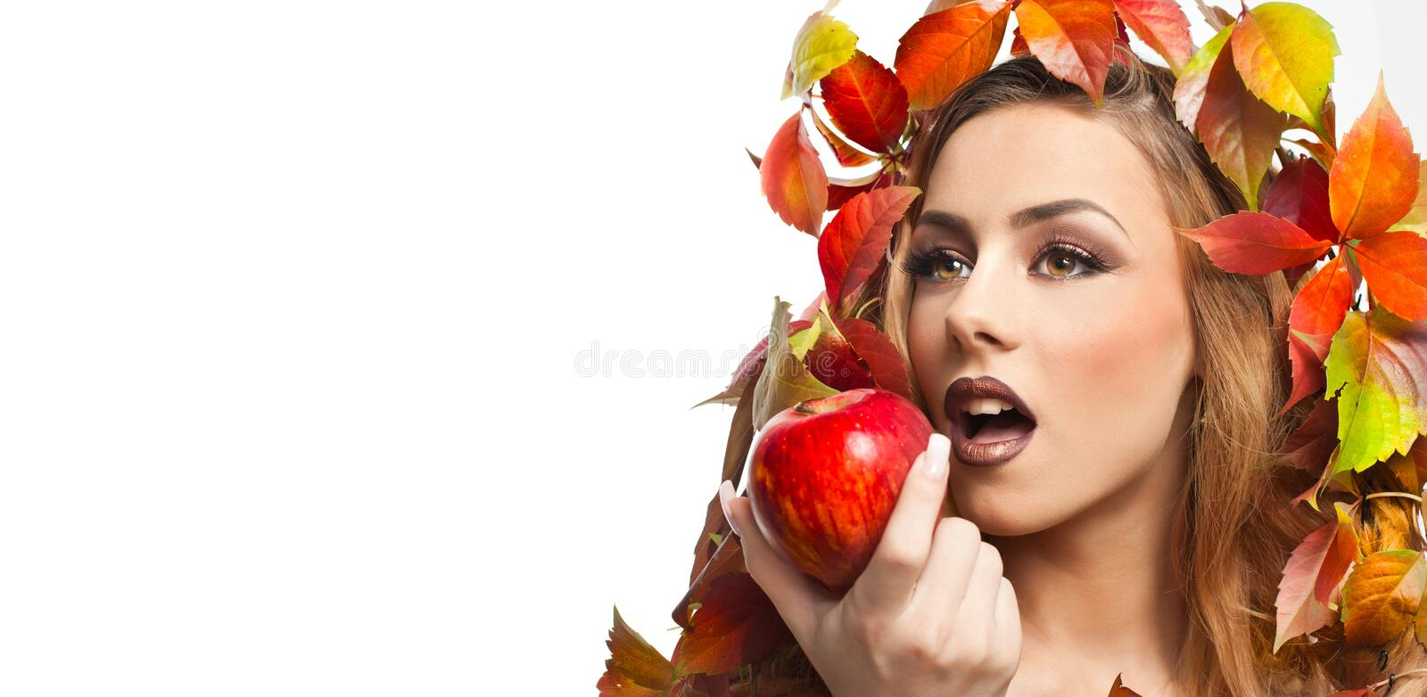 Autumnal woman. Beautiful creative makeup and hair style in fall concept studio shot. Beauty fashion model girl with fall makeup. Autumnal woman. Beautiful royalty free stock photography