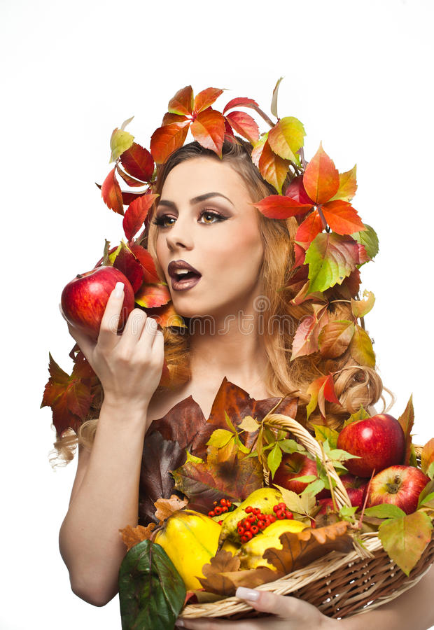 Autumnal woman. Beautiful creative makeup and hair style in fall concept studio shot. Beauty fashion model girl with fall makeup. Autumnal woman. Beautiful stock images