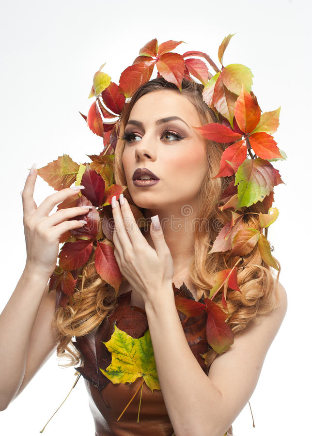 Autumnal woman. Beautiful creative makeup and hair style in fall concept studio shot. Beauty fashion model girl with fall makeup. Autumnal woman. Beautiful stock photo