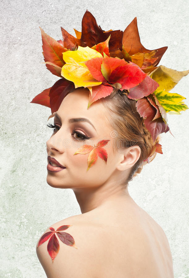 Autumnal woman. Beautiful creative makeup and hair style in fall concept studio shot. Beauty fashion model girl with fall makeup. Autumnal woman. Beautiful stock image