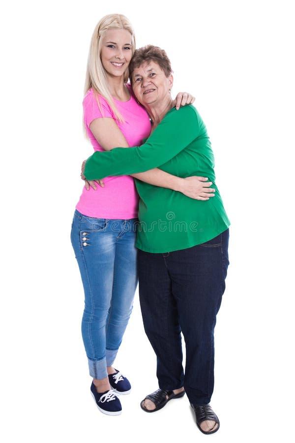 Avó de abraço isolada da neta do comprimento completo do corpo foto de stock royalty free