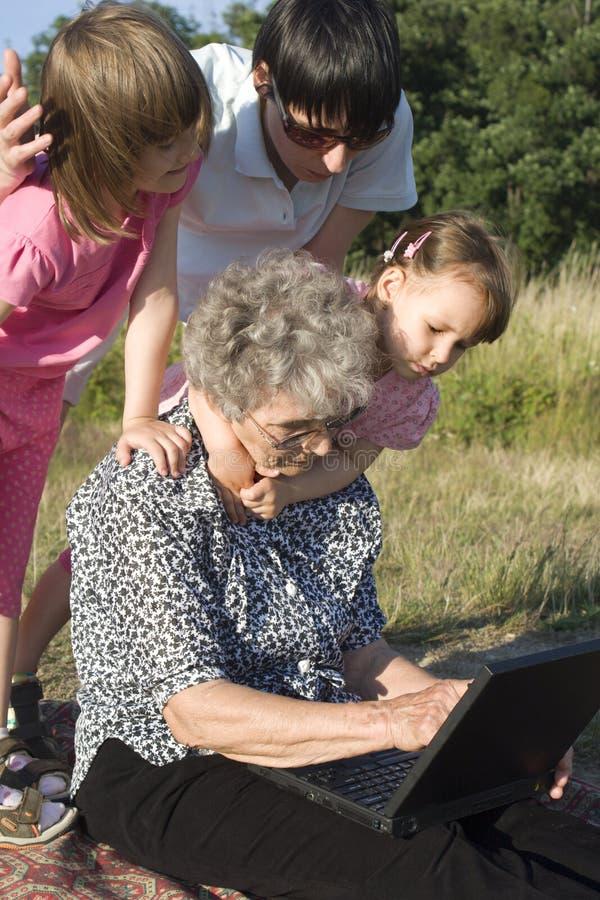 Avó e netos imagens de stock royalty free