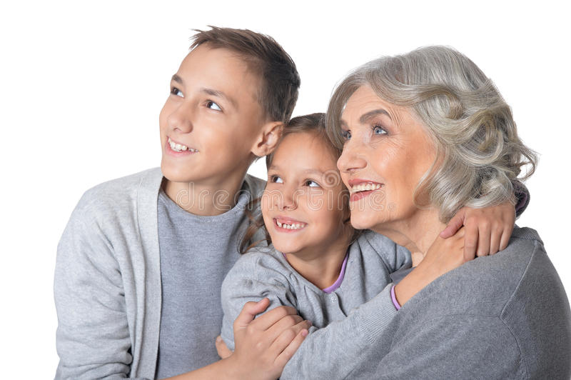 Avó feliz com seus netos imagem de stock royalty free