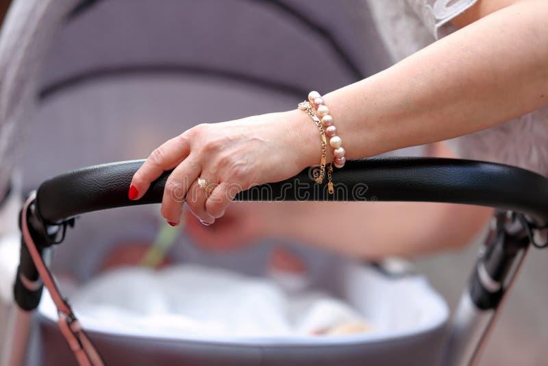 A avó toma do bebê no pram foto de stock royalty free