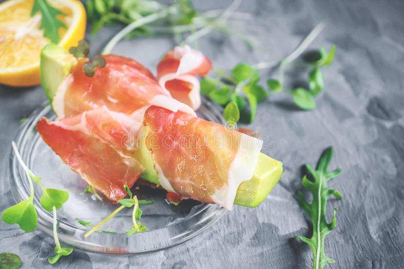 Avacado with bacon, traditional breakfast. Healthy food for weight normalization royalty free stock image