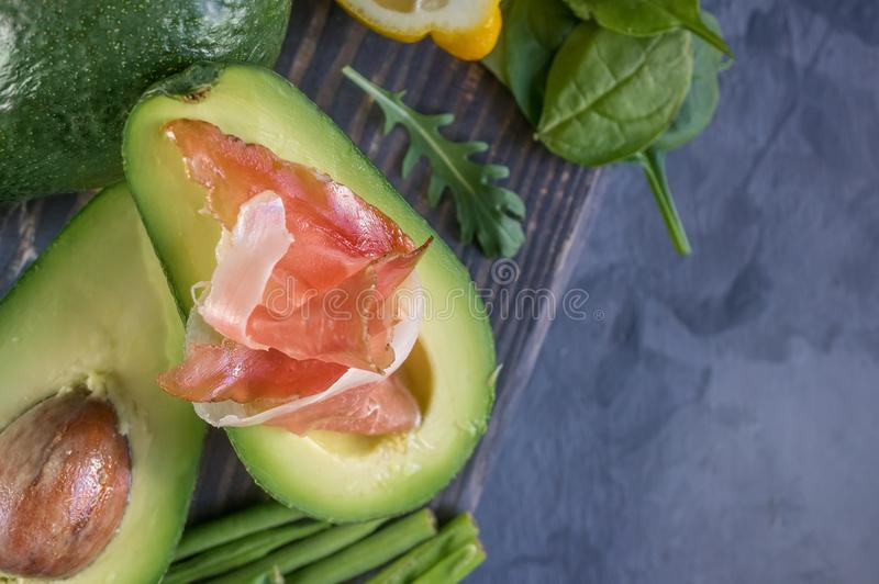 Avacado with bacon, traditional breakfast. Healthy food for weight normalization stock photos