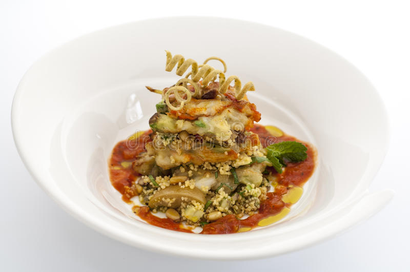 Avacado and cous cous with tomato relish. And pine nuts royalty free stock photo