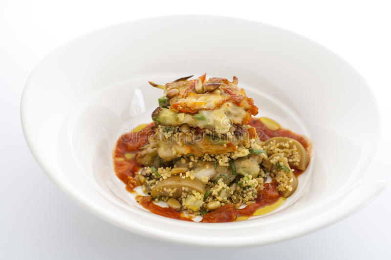 Avacado and cous cous with tomato relish. And pine nuts stock photos