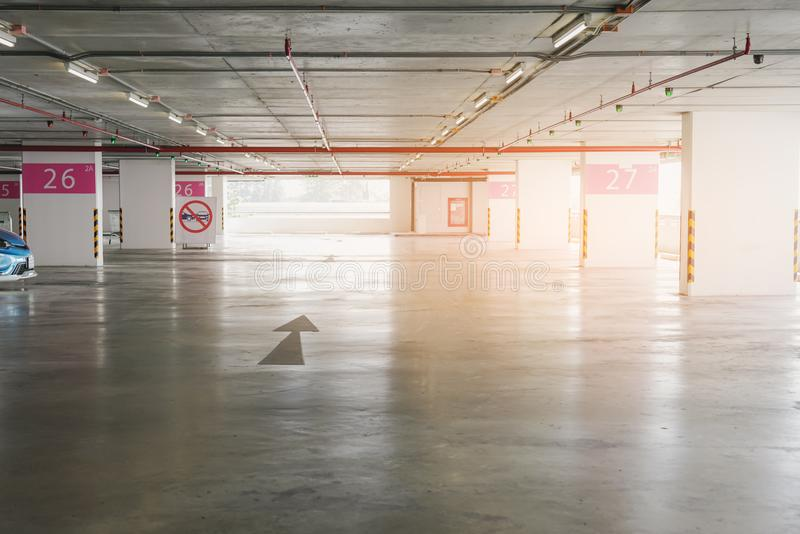 Available car parking in building, with green light. Showing empty space royalty free stock photo