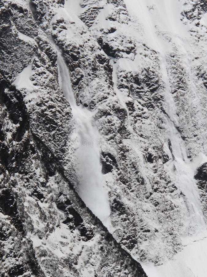 Avalanche. Photographed from the Machhapuchhre Base Camp stock image