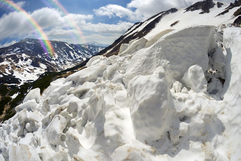Avalanche in the Carpathians. Powerful avalanche danger in the rural Carpathian Ukraine, which is pulled down a slope of Black Mountain. dangerous for tourists stock image