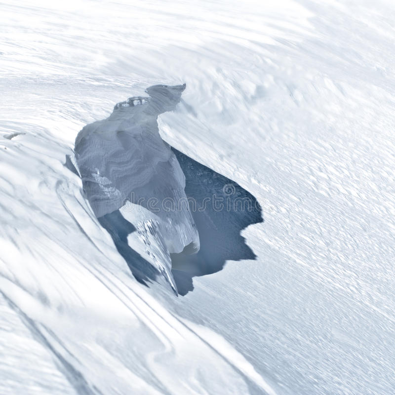 Avalanche causer. Imminent snow visor, causing avalanche stock image