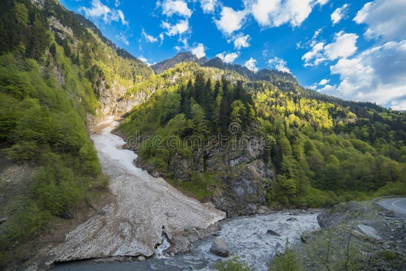 The avalanche descends into the river stock photos