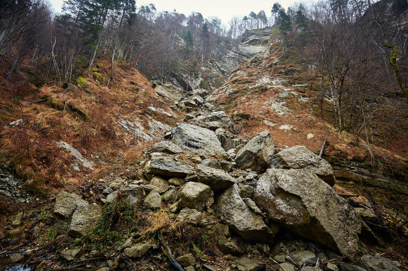 Avalanche with huge rocks. Landscape with immense boulders disrupted by an avalanche in the mountains stock photography