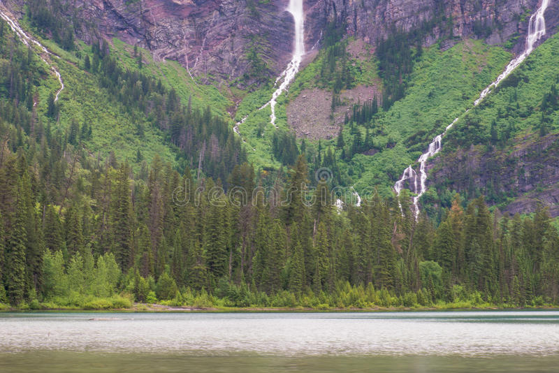 Avalanche Lake view of the center with three waterfalls. This is an image taken at Avalanche Lake in Glacier National Park in Montana, of a center spot where royalty free stock photo