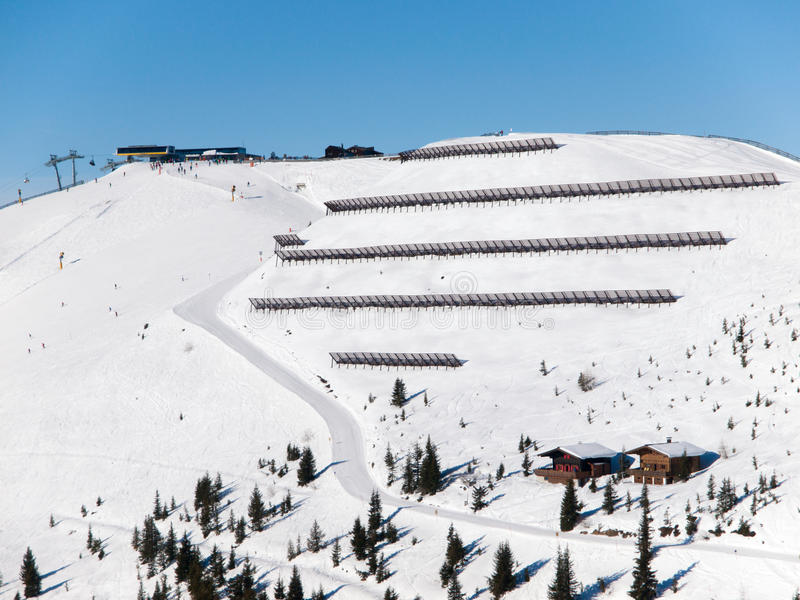 Avalanche protection barriers on steep slope in winter ski resort. Sunny winter day in mountains, Alps, Austria.  stock images