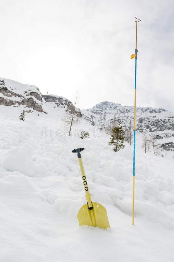 Avalanche shovel and probe. Back country safety equipment royalty free stock photo