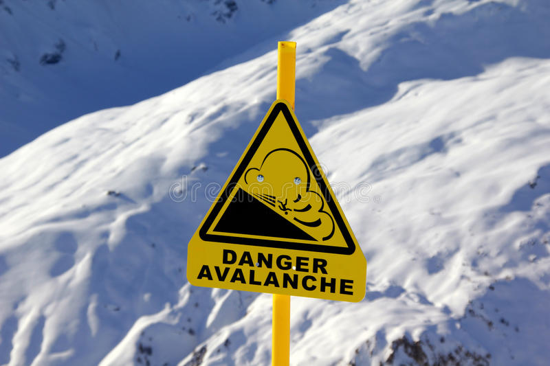 Avalanche sign. In the snow stock photography