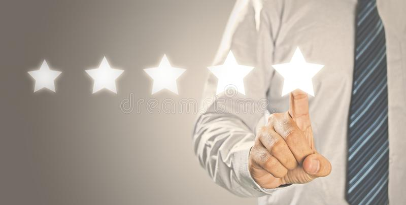 Avaliação do aumento, avaliação de cinco estrelas foto de stock royalty free