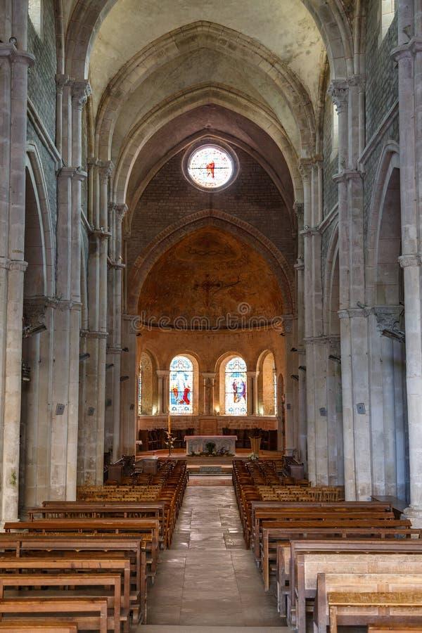 Interior of Romanesque church in Avallon, France. AVALLON / FRANCE - JULY 2015: Interior of Romanesque church in Avallon, France royalty free stock images