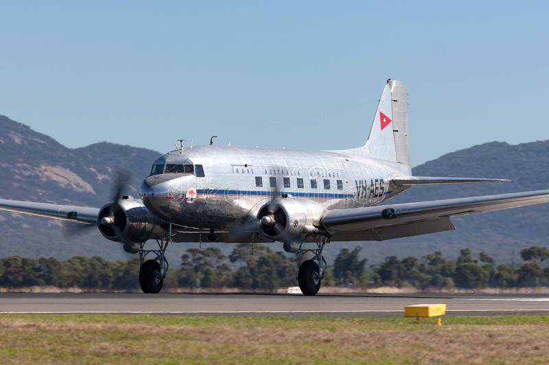 Vintage Douglas DC-3C airliner VH-AES in Trans Australian Airlines livery. Avalon, Australia - March 3, 2013: Vintage Douglas DC-3C airliner VH-AES in Trans royalty free stock images