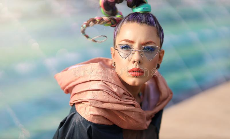 The avant-garde portrait girl with unusual make up and fancy sun glass. Avangarde fashion royalty free stock photo
