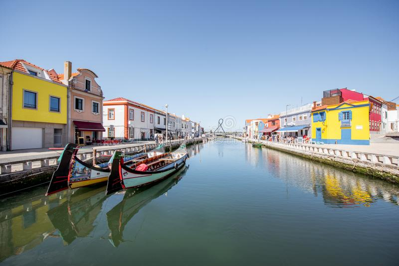 Aveiro city in Portugal. View on the water channel with boats and colorful old buildings in Aveiro city in Portugal stock images