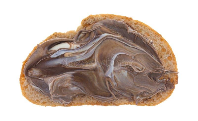 Avellana y chocolate blanco separados en el pan fotografía de archivo libre de regalías