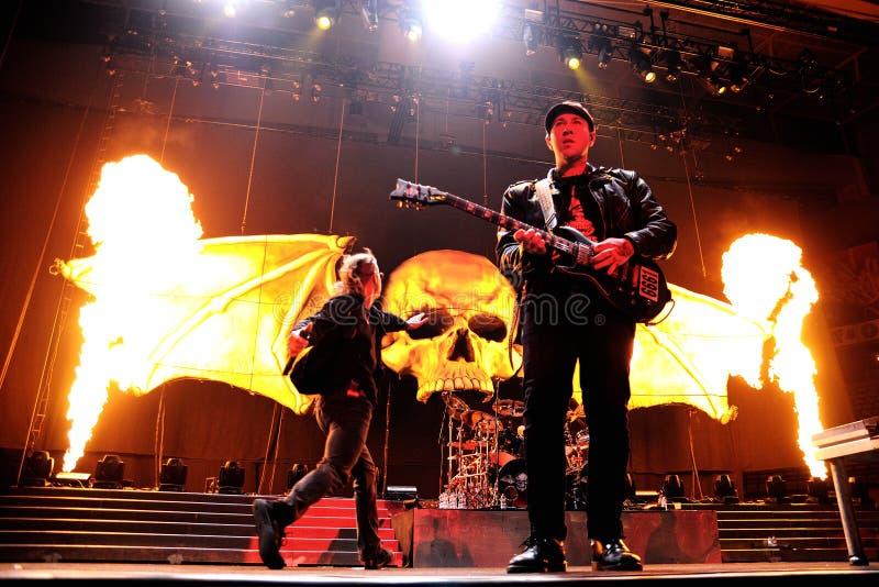 Avenged Sevenfold, famous heavy metal band, concert at Olimpic de Badalona stage. BARCELONA - NOV 25: Avenged Sevenfold, famous heavy metal band, concert at royalty free stock photo